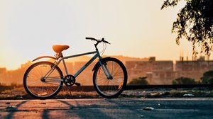 Preview wallpaper bike, sunset, horizon, sky