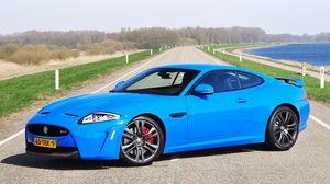 Preview wallpaper blue, jaguar, road, grass, lake, trees