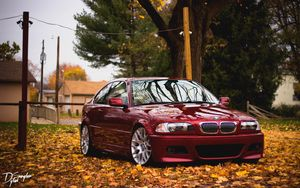 Preview wallpaper bmw, red, side view, foliage, autumn