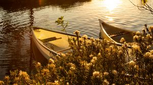 Preview wallpaper boats, river, rays, bushes