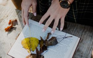 Preview wallpaper book, leaves, hands, autumn, aesthetics
