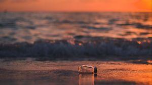 Preview wallpaper bottle, glass, sea, sunset, shore, blur
