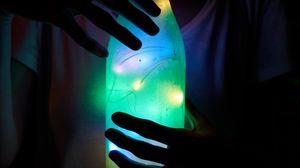Preview wallpaper bottle, glow, fingers, light bulbs, dark