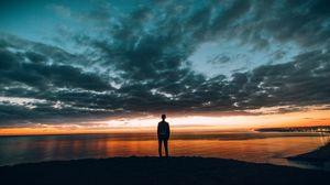 Preview wallpaper boy, sunset, horizon, sea