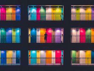 320x240 Wallpaper building, multicolored, doors, balconies, silhouette