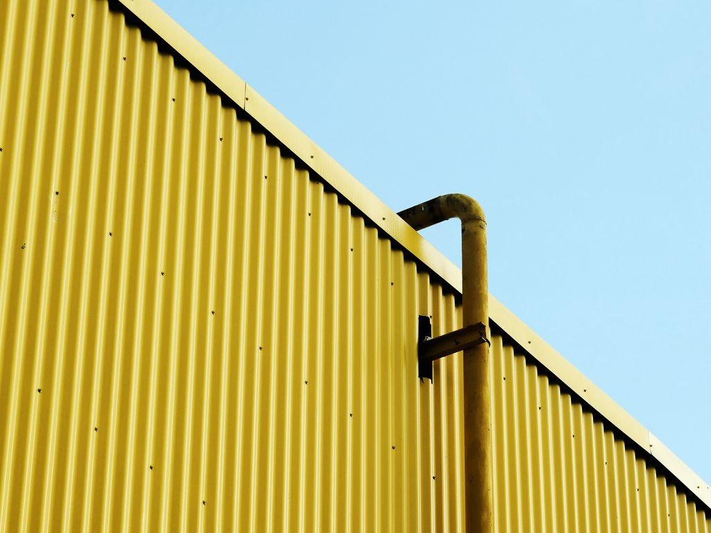 1024x768 Wallpaper building, pipe, yellow, minimalism