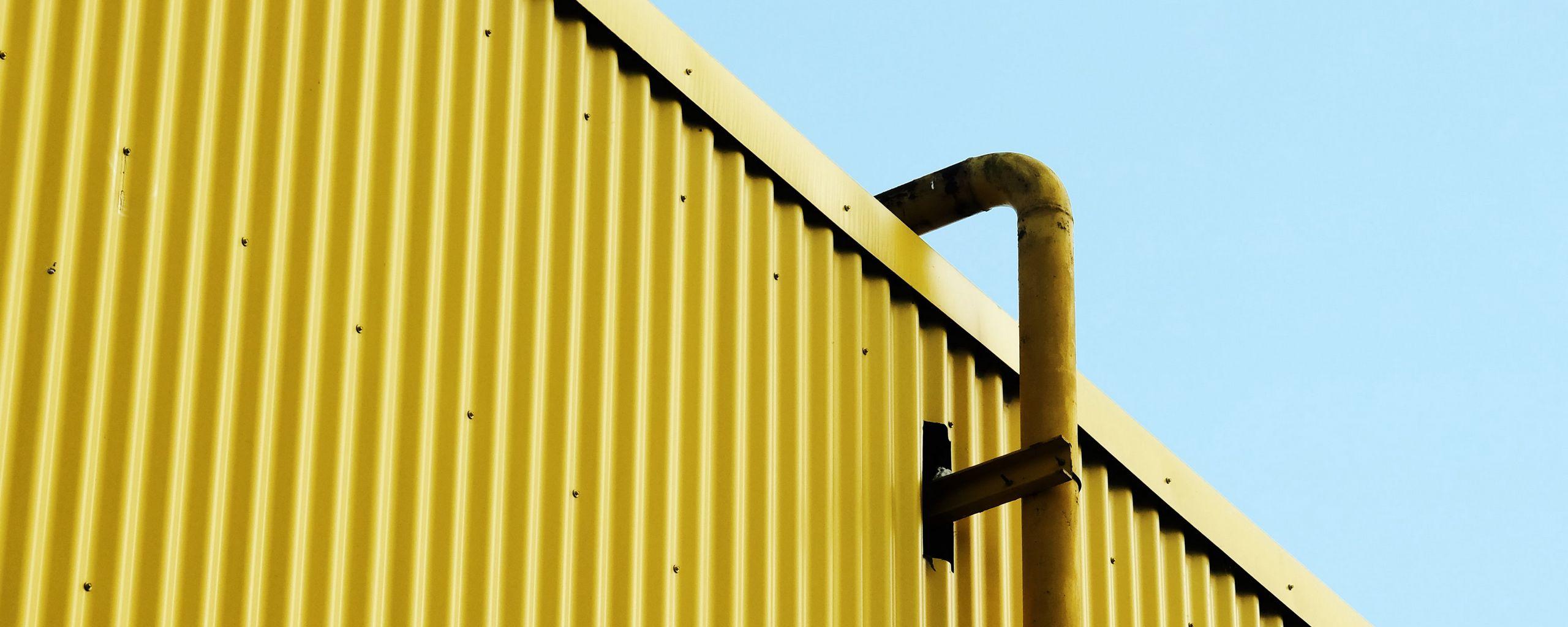 2560x1024 Wallpaper building, pipe, yellow, minimalism
