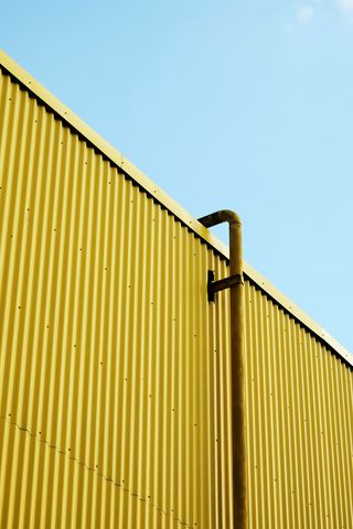 320x480 Wallpaper building, pipe, yellow, minimalism