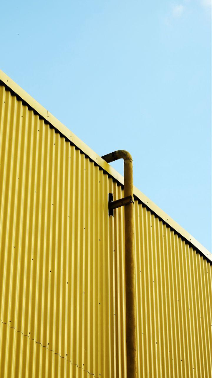 720x1280 Wallpaper building, pipe, yellow, minimalism