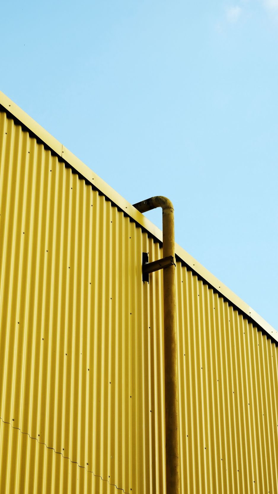 938x1668 Wallpaper building, pipe, yellow, minimalism