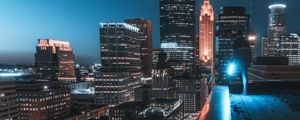 Preview wallpaper buildings, roof, man, city, night