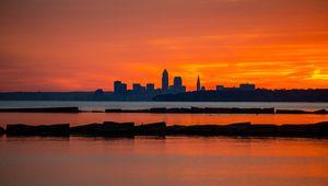 Preview wallpaper buildings, silhouettes, water, sunset, horizon, dark