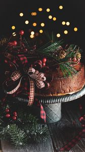 Preview wallpaper cake, branches, spruce, cones, bow, decoration