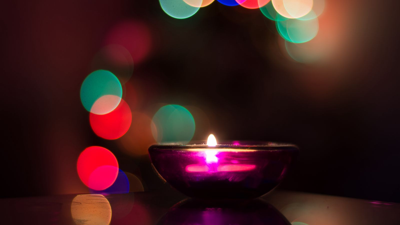 1600x900 Wallpaper candle, flare, shine