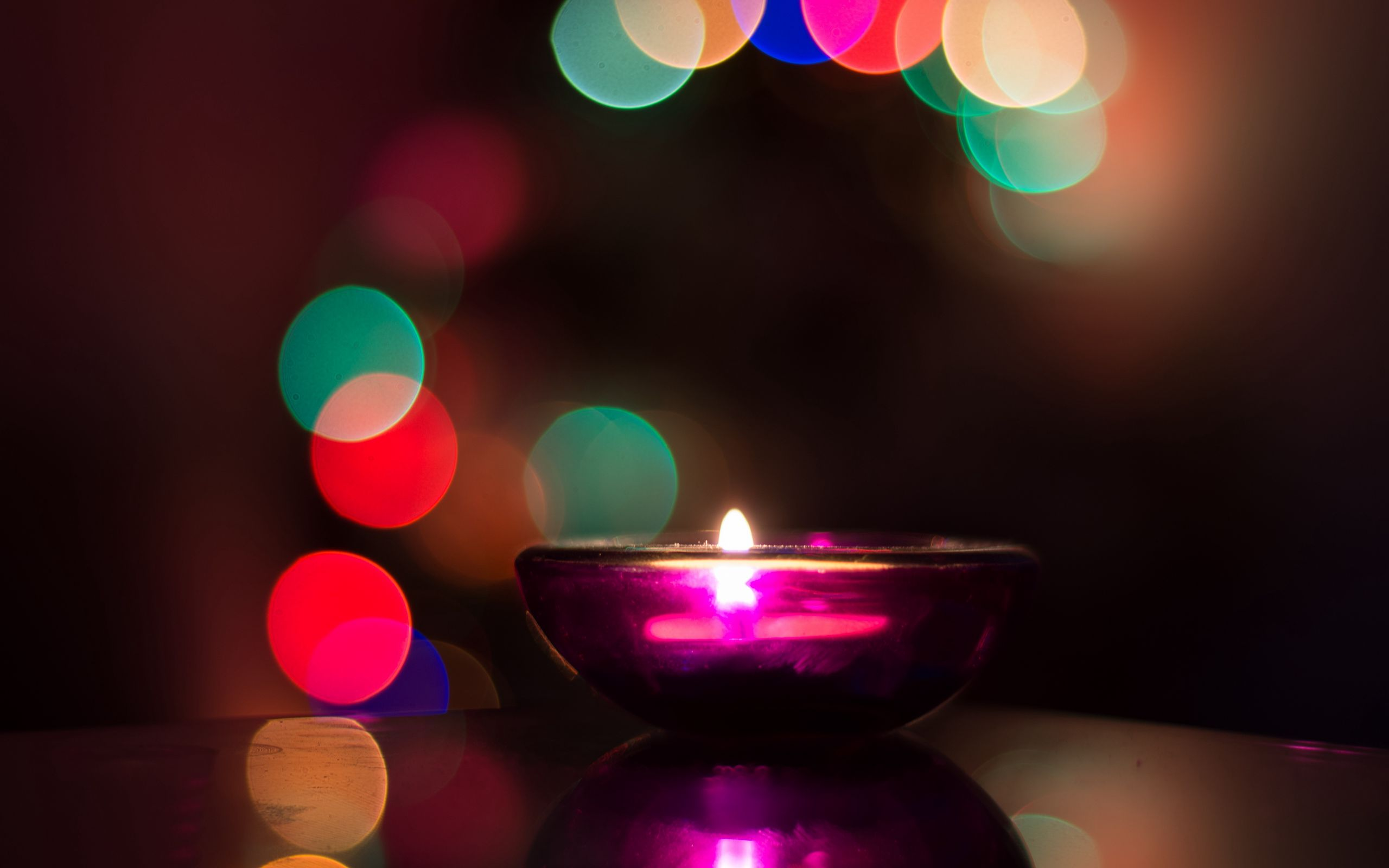 2560x1600 Wallpaper candle, flare, shine