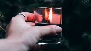 Preview wallpaper candle, hand, branches, spruce