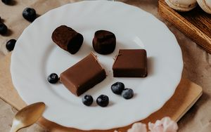 Preview wallpaper candy, chocolate, berries, dessert, plate
