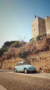 Preview wallpaper car, blue, retro, tower, architecture