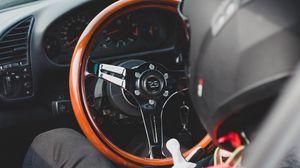 Preview wallpaper car, steering wheel, racer, helmet, salon