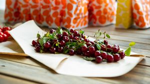 Preview wallpaper cherry, berries, leaves, parchment, macro
