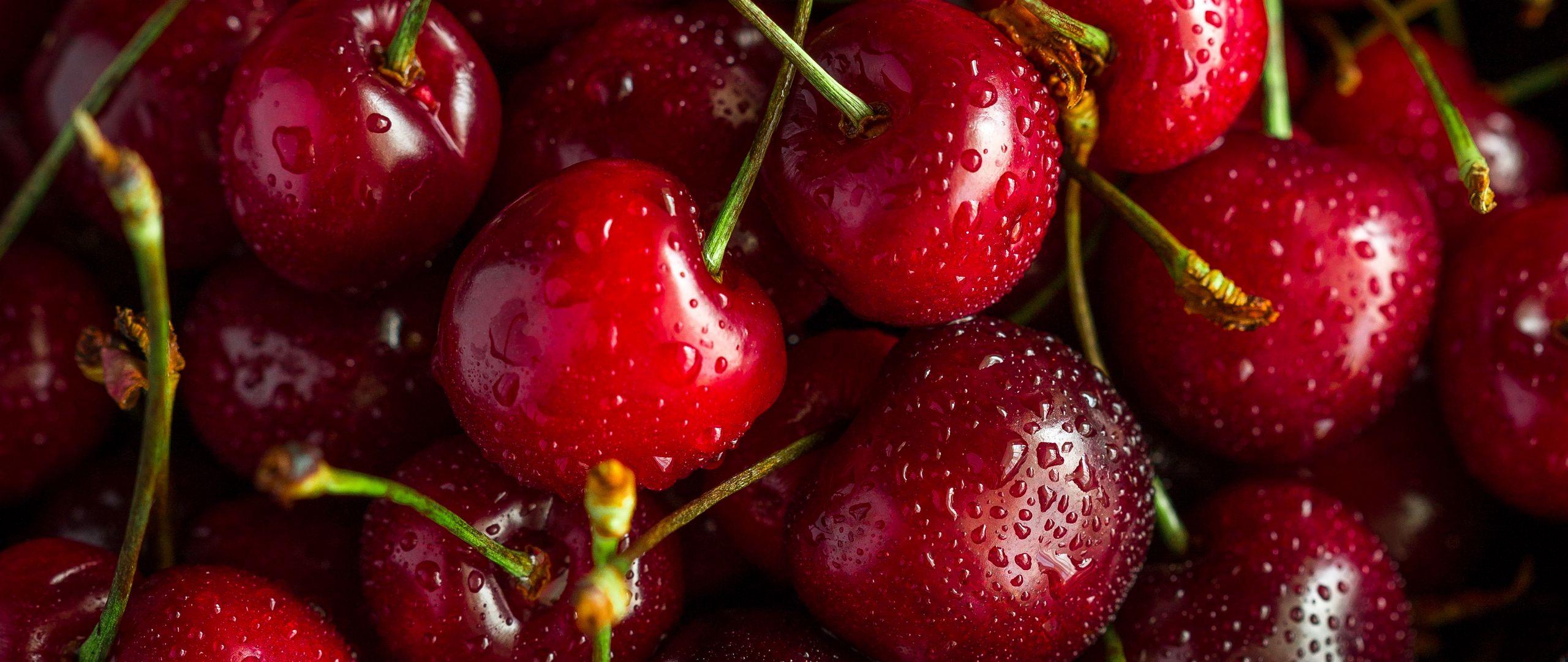 2560x1080 Wallpaper cherry, ripe, wet, berries, harvest, red, drops