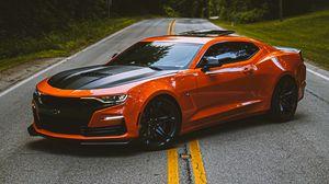 Preview wallpaper chevrolet camaro, car, sportscar, orange, side view, road