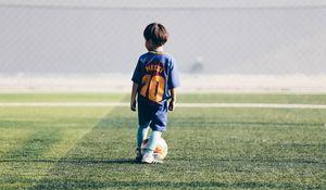 Preview wallpaper child, football player, football, football field, ball, lawn