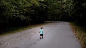 Preview wallpaper child, run, road, forest, asphalt