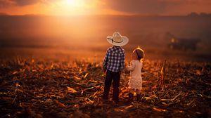 Preview wallpaper children, sunset, grass, sky