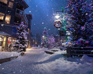 Preview wallpaper christmas, new year, winter, street, snowfall, mood