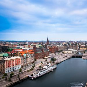 Preview wallpaper city, buildings, architecture, river, boat, aerial view