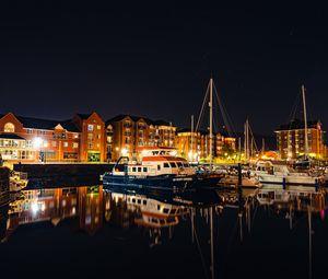 Preview wallpaper city, buildings, boats, pier, night, dark