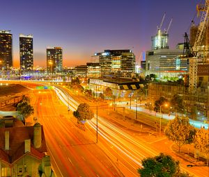 Preview wallpaper city, buildings, road, twilight, lights, aerial view