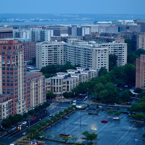 Preview wallpaper city, buildings, road, aerial view, twilight