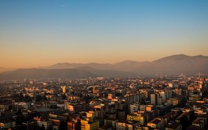 Preview wallpaper city, buildings, roofs, mountains, aerial view