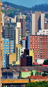 Preview wallpaper city, buildings, trees, colorful, aerial view