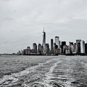 Preview wallpaper city, buildings, water, waves, metropolis, black and white