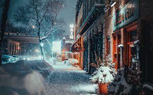 Preview wallpaper city, evening, snowfall, winter, street, buildings