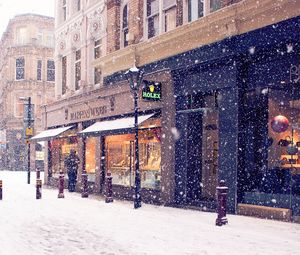Preview wallpaper city, winter, europe, street, snow, shopping