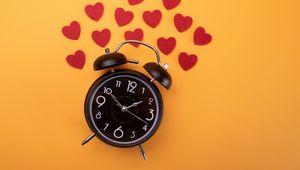 Preview wallpaper clock, alarm clock, time, hearts, orange