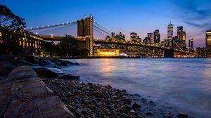 Preview wallpaper coast, bridge, lights, water, twilight