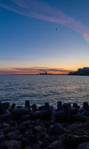 Preview wallpaper coast, sea, water, buildings, horizon, twilight