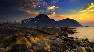 Preview wallpaper coast, stones, smooth, wet, sea, mountains, evening, sky