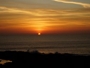 Preview wallpaper coast, sunset, sun, landscape, dark