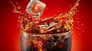 Preview wallpaper coca-cola, ice, glass, splashes