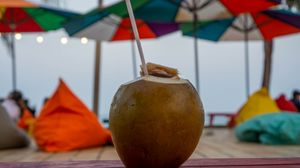 Preview wallpaper coconut, nut, straw, drink