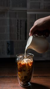 Preview wallpaper coffee, milk, ice, glass, hand