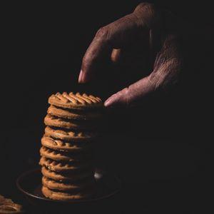 Preview wallpaper cookies, stack, dessert, hand, dark