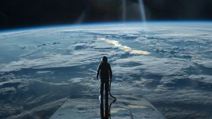 Preview wallpaper cosmonaut, space, planet, atmosphere, surface, glow