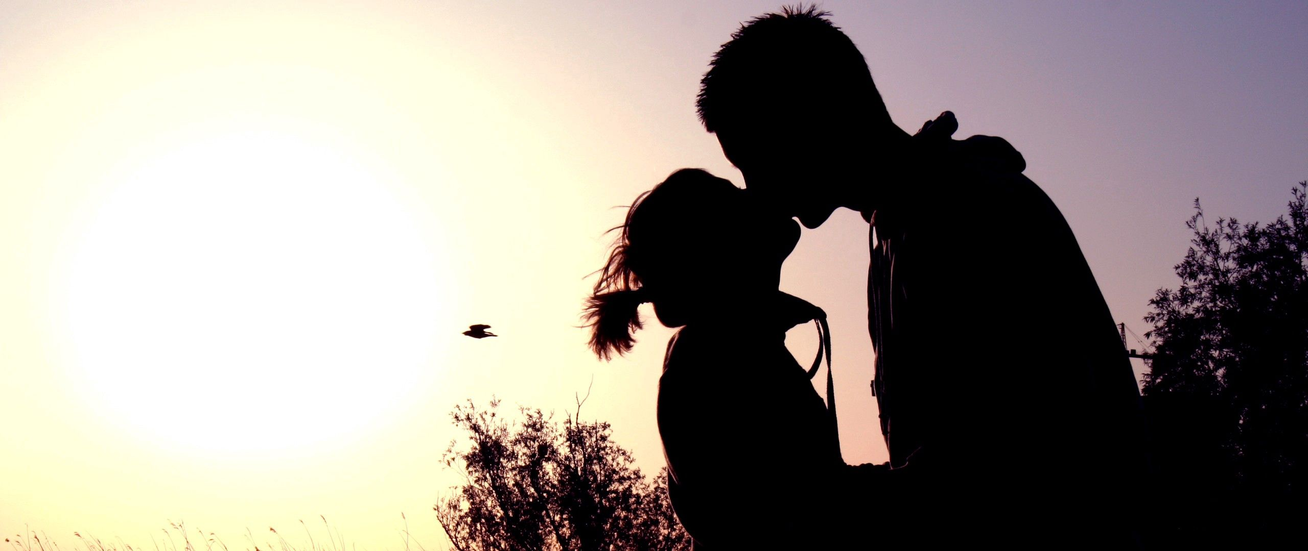 2560x1080 Wallpaper couple, shadow, sunset, kissing, hugging, romance